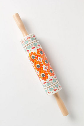 Super cute Anthropologie orange flower gold