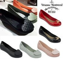 Vivienne Westwood Collaboration PVC Clothing Pumps & Mules