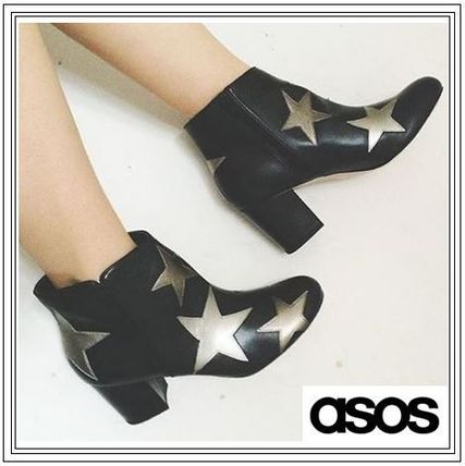 popular ASOS star patterned ankle boots on into
