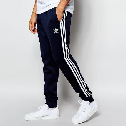 uk availability cb719 076ba adidas SUPERSTAR 2016 SS Stripes Sweat Street Style Plain Joggers &  Sweatpants