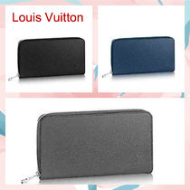 Louis Vuitton TAIGA Unisex Street Style Plain Leather Long Wallets