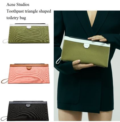 Acne Toothpaste triangle shaped clutch bag