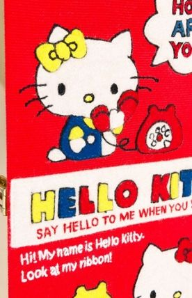 In the Olympia Le-Tan Hello Kitty book clutch