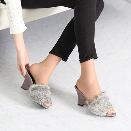 It's fluffy fur suede wedge mules