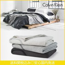 Calvin Klein Plain Throws