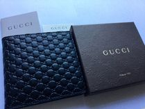 GUCCI Leather Folding Wallets