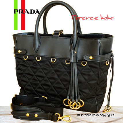 Black Quilted Nylon Tessuto Tote Bag WIth Gold Metal Rings
