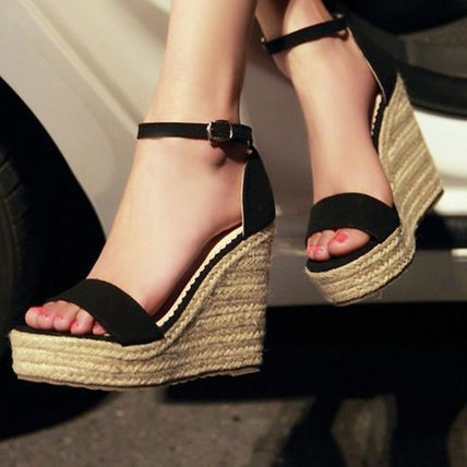 Wedge sole high heeled sandals