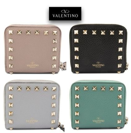 Rock studded compact wallet