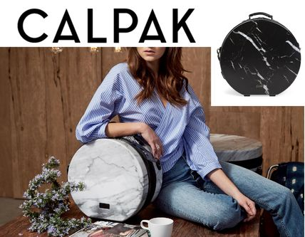 Beautiful CALPAK marble round-minitrunk carry case small