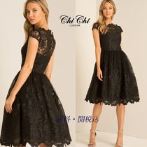 Chi Chi London Puffed Sleeves Flared Boat Neck Medium Party Dresses