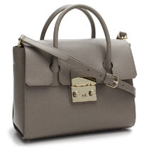 FURLA Plain Leather Handbags