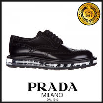 PRADA Wing Tip Plain Leather Oxfords