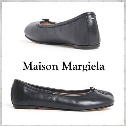 And Maison Margiela flat shoes