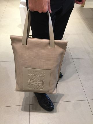 Beige tote with bag logo