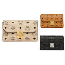 MCM Street Style Leather Clutches