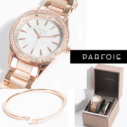 With bracelet glittering pink gold watches