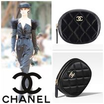 CHANEL Black caviar leather quilted coin case