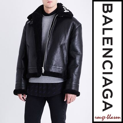 Logo-print leather and shearling jacket