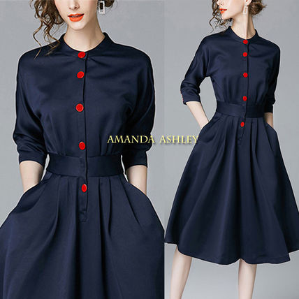 Contrast red button bottle neck navy dress