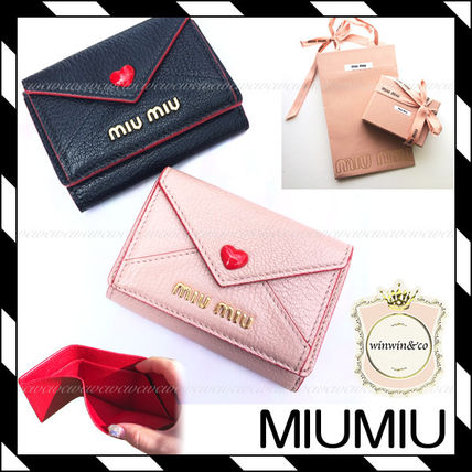 MiuMiu MADRAS Plain Leather Folding Wallets