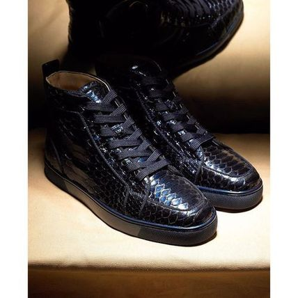 check out 6aac7 dd9c5 buy louboutin black snakeskin sneakers boots 545e7 bbbc7