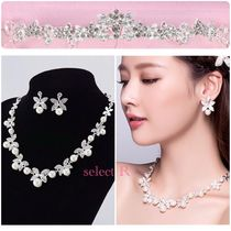 With Jewels Wedding Jewelry