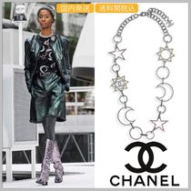 CHANEL Long star & moon metal necklace