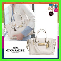 Coach SWAGGER Chalk (White) Pebbled Leather Swagger 27 Handbag