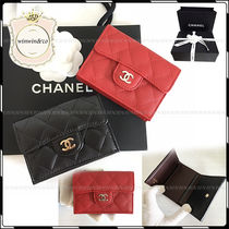 CHANEL Leather Folding Wallets
