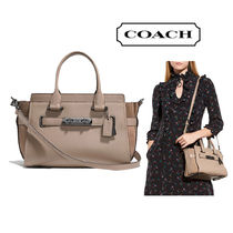 Coach SWAGGER Stone Beige Pebbled Leather Swagger 27 Handbag