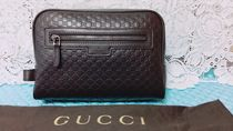 GUCCI Leather Clutches