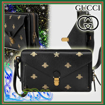 GUCCI Star Leather Clutches