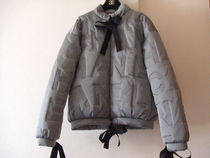 CHANEL Down Jackets