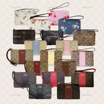 Coach Leather Pouches & Cosmetic Bags