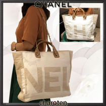 CHANEL ICON Ivory Printed Fabric Maxi Chanel Large Shopping Bag