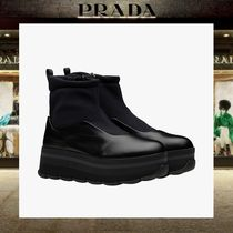 PRADA Plain Toe Plain Wedge Boots