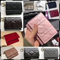 Christian Dior Plain Leather Folding Wallets