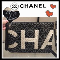 CHANEL ICON Flower Patterns Unisex Bag in Bag Leather Clutches