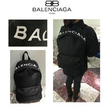 BALENCIAGA Unisex Nylon A4 Plain Backpacks