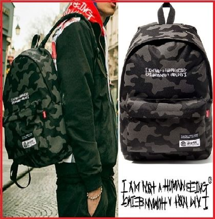 d6ded6cec28c I AM NOT A HUMAN BEING Camouflage Unisex Street Style A4 Backpacks