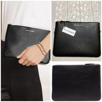 COMME des GARCONS Unisex Plain Leather Clutches