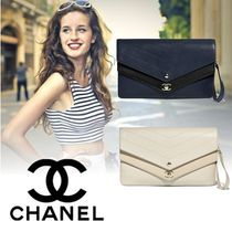 CHANEL Studded Plain Leather Elegant Style Clutches