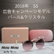 MiuMiu Round With Jewels Sunglasses