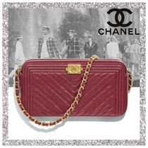 CHANEL BOY CHANEL Calfskin Clutches