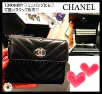 CHANEL Studded Folding Wallets