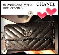CHANEL Lambskin Studded Folding Wallets