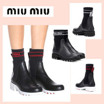 MiuMiu Round Toe Rubber Sole Leather Ankle & Booties Boots