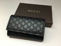 GUCCI Unisex Leather Logo Keychains & Bag Charms
