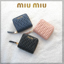 MiuMiu MATELASSE Plain Leather Folding Wallets